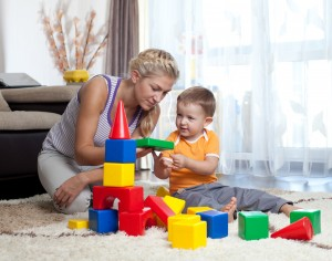 cute mother and child boy playing together indoor